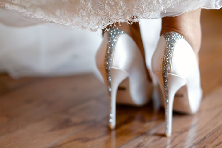 These bold sparkly Badgley Mischka bridal heels are not to be ignored: The stripe of silver sparkles down the back of these heels was a gorgeous glam touch to Chloe's classic bridal style.
