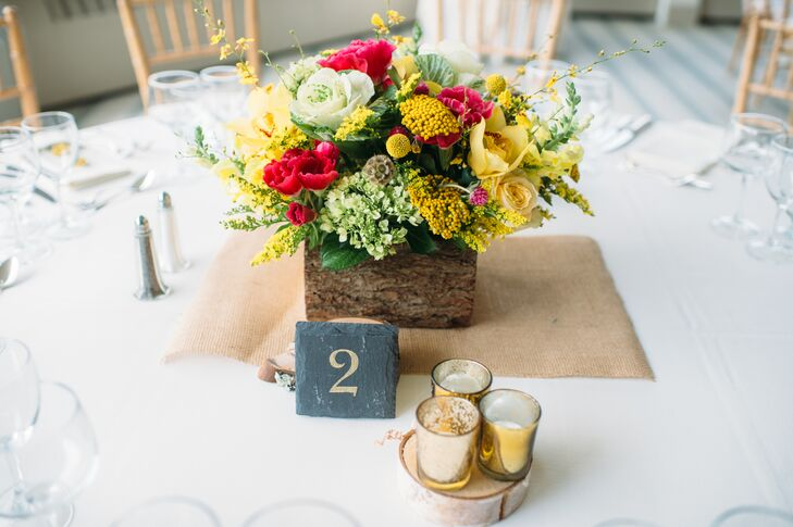 Lauren's father cut slabs out of hundreds of wooden branches from their backyard to make coasters for the gold mercury glass votives to sit on as part of the tablescapes at the reception.