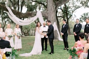 Classic Bride and Groom at Outdoor Ceremony with Draped Tree Backdrop