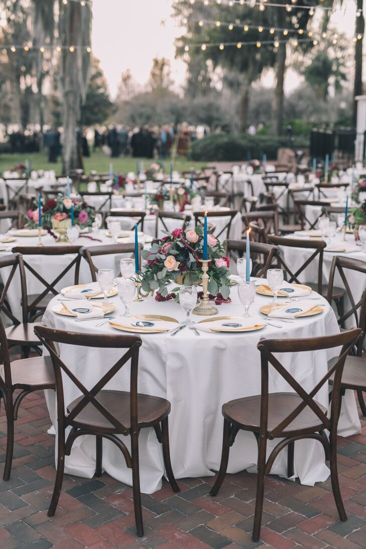 Tables with Navy Taper Candles and Cross-back Chairs