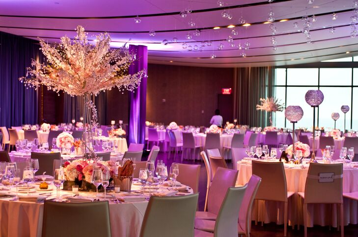 when Kim and Randy saw the breathtaking ocean view through the floor-to-ceiling windows at One Atlantic's ballroom, they were sold on the venue. To heighten the drama, reception tables were decorated with crystal bling trees and pink orchids.