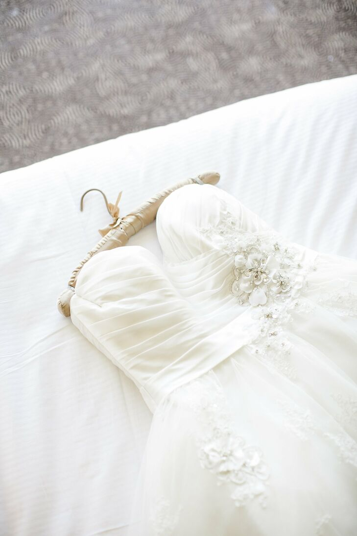 Emily's strapless Maggie Sottero gown gave off a retro vibe with its voluminous-yet-short skirt.