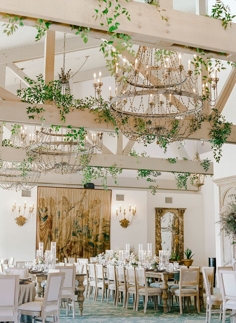 Rustic country club wedding reception with hanging greenery
