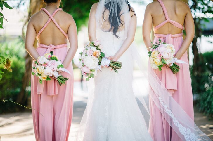 Samantha tried on over 100 dresses in order to gather inspiration for her custom-made gown. Bridesmaids wore long infinity-style dresses that they customized themselves and accented with rose gold jewelry.