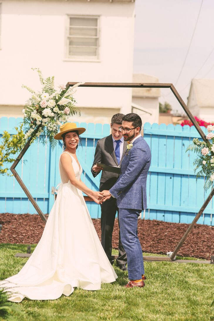 Casual Outdoor Ceremony with Modern Geometric Arch Backdrop