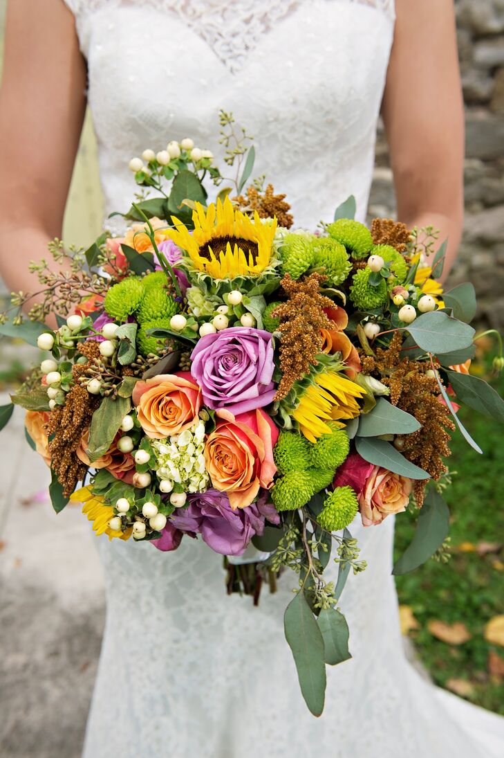Courtney carried a bouquet of blush and lavender roses, sunflowers, green chrysanthemums, white hypericum berries and eucalyptus leaves. The colors were perfect for the fall season.
