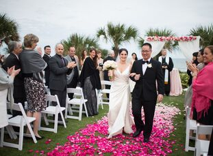 From the pink ombre aisle decor to the hanging chandelier lighting, Jeanine Parisi (33 and in marketing) and Allen Ng (33 and a stockbroker) had a rom