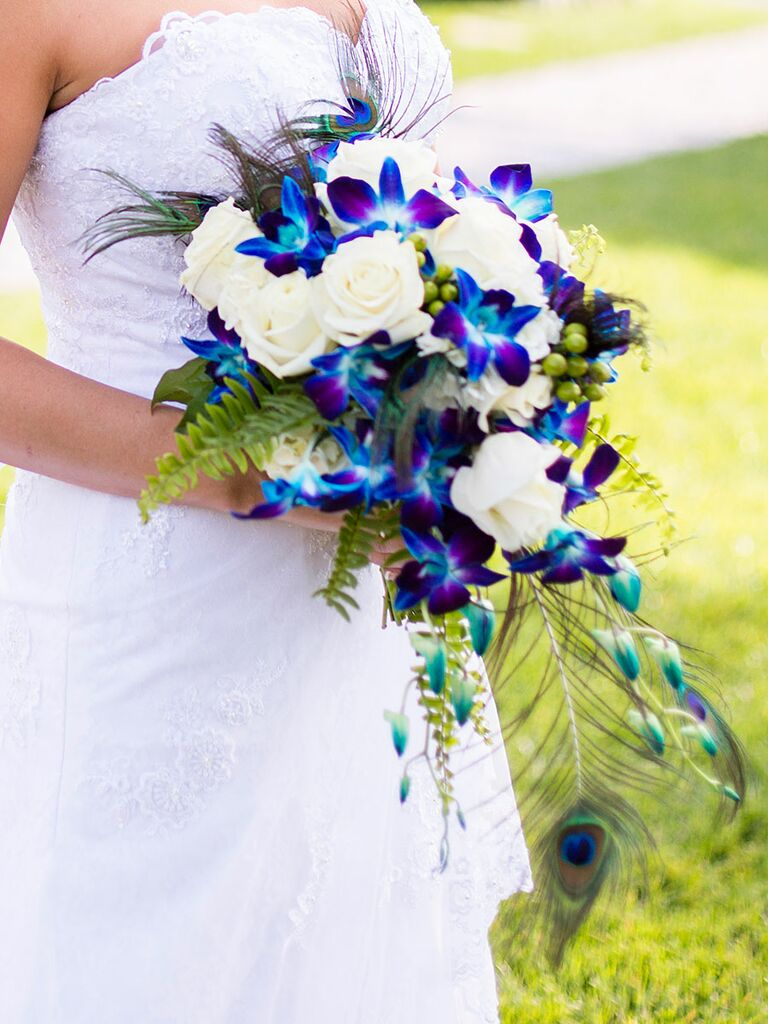 The best blue wedding flowers and 16 gorgeous blue bouquets blue wedding bouquet with roses orchids ferns and peacock feathers junglespirit