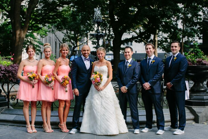 The bridesmaids and groomsmen had a classic look in navy suits and coral dresses, but added fun elements like bright bouquets for the girls and Converse shoes for the guys.