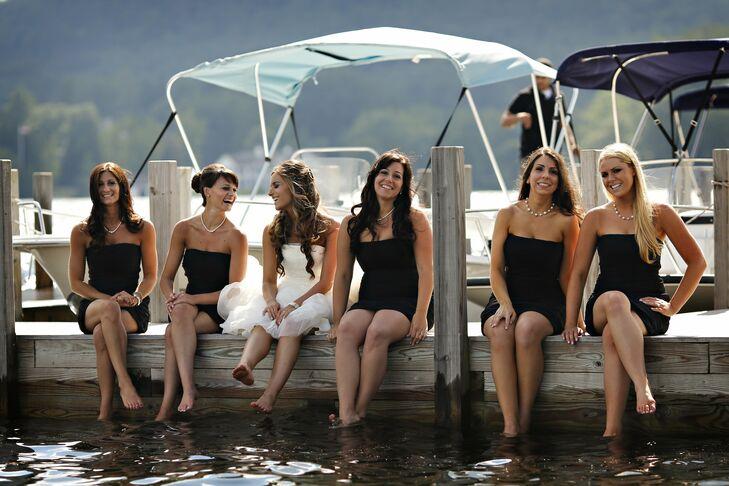 Bridesmaids donned dark navy blue dresses by Monique Lhuillier for the celebration.