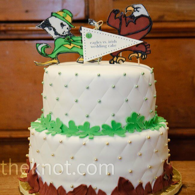 Instead of a formal wedding cake, the couple opted for a fun, sports-themed one. It paid homage to their love of college football and their rival alma maters.