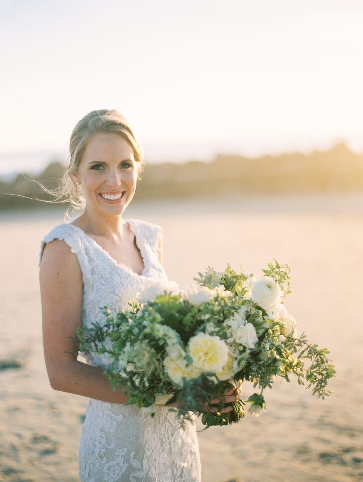 "Eliza's luscious white blossom bouquet was an elegant match for her Monique Lhuillier lace gown. ""It was made from two different layers of French lace with chiffon layered underneath. This created that gorgeous texture,"" Eliza says."