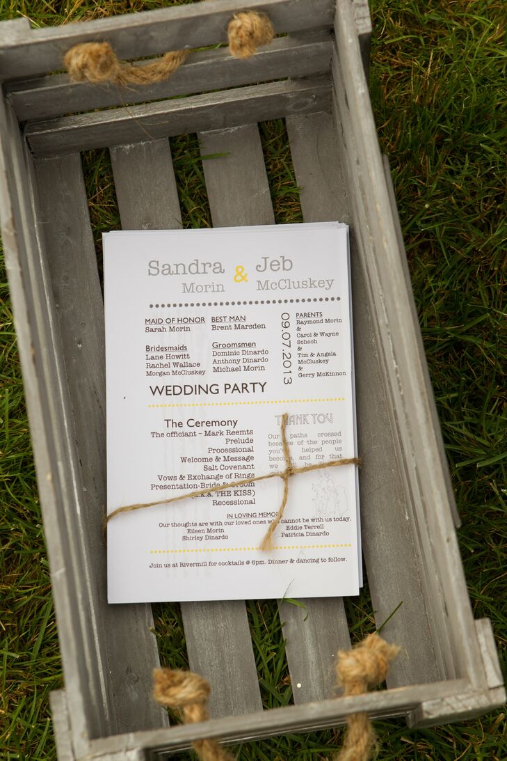 The couple created their programs and menu cards, using yellow and gray accents to tie into the color palette of the celebration.