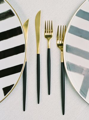 Gold Flatware and Striped Chargers