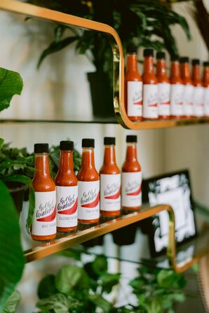 Personalized Hot Sauce Escort Cards on Modern Shelves