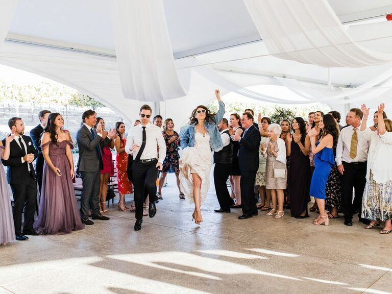 Bride and groom dancing in flash mob at wedding reception