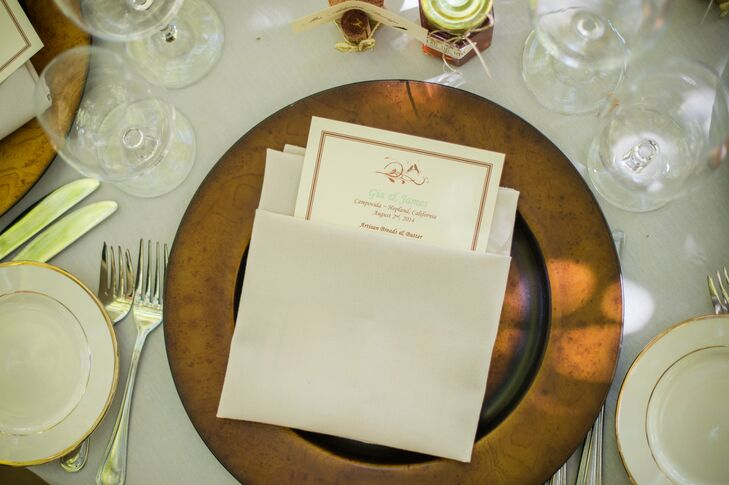The border of the menu cards picked up on the warm coppery tone of the charger plates.