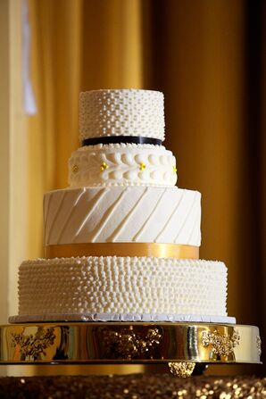 Butter Cream Four-Tiered Cake with Black and Gold Accent