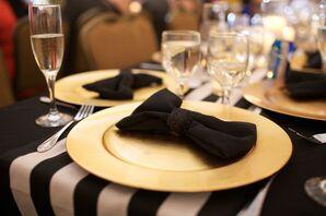 Black Bow and Gold Plate Decor with Striped Table Runner
