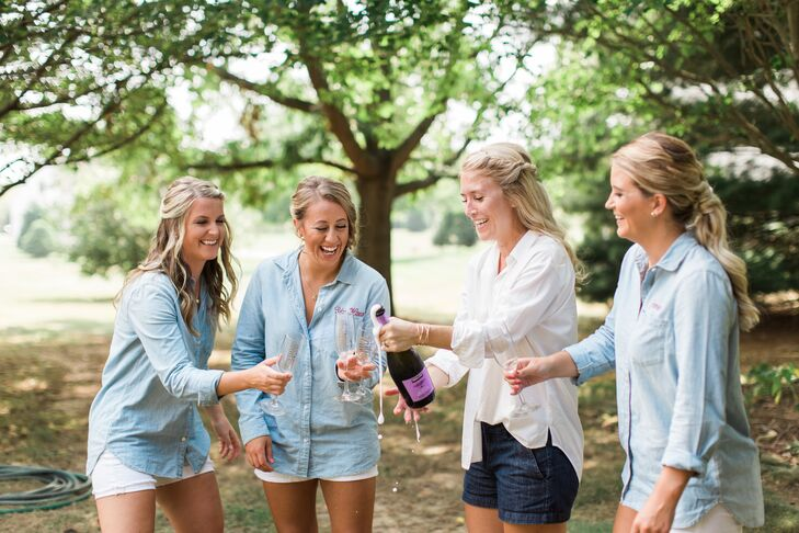 As a gift to her bridesmaids, Megan had chambray shirts monogrammed with each one's initials, which they wore while they sipped champagne and got ready for the day's festivities.
