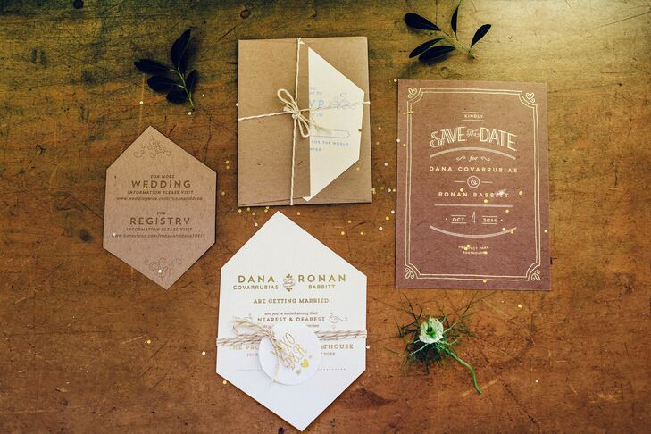 The gem-cut invitations were printed on kraft paper with gold foil-pressed lettering. The inside of the envelopes had gold gems, and the front was addressed to each guest with a gem above their name. The couple filled each invitation with silver and gold confetti and tied everything together with a metallic string.