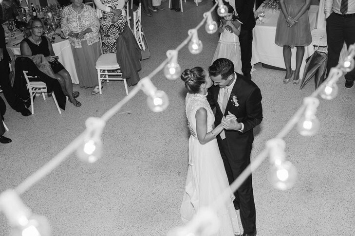 Bride and Groom Dance Under Lights