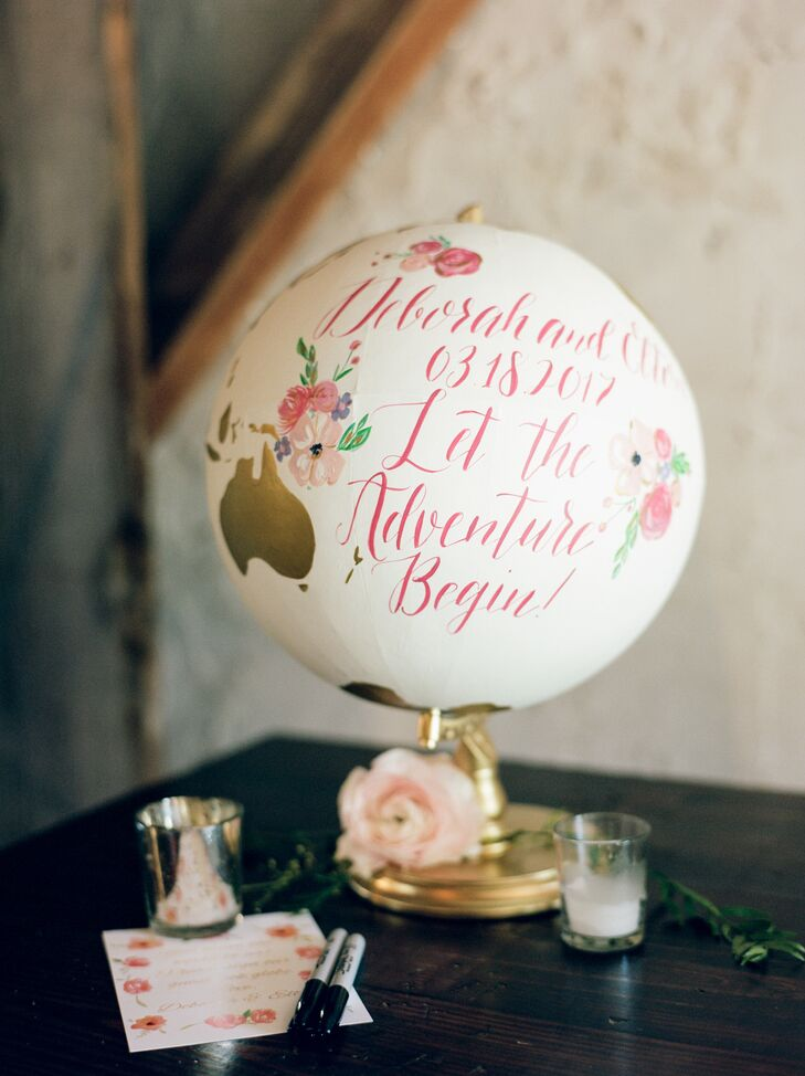 A handcrafted globe calligraphed with Deborah and Elton's wedding date sat at the guest book and gift table for a personal touch.
