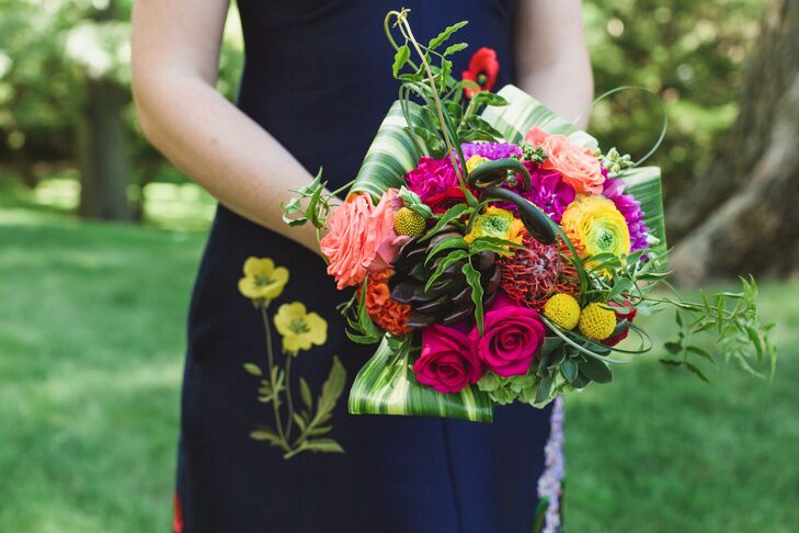 Vibrant Textured Bouquet with Proteas and Folded Leaf Halo