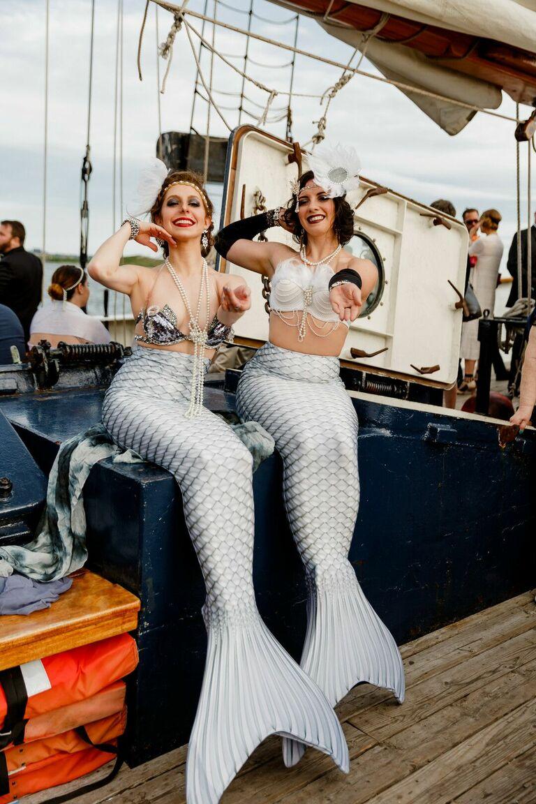 Mermaid entertainers on boat