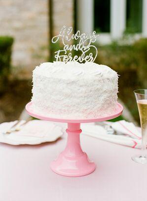 Single-Tier Wedding Cake on Pink Stand