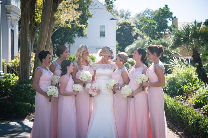 The bridesmaids wore long blush chiffon dresses from Flutter Boutique in Minneapolis, MN.