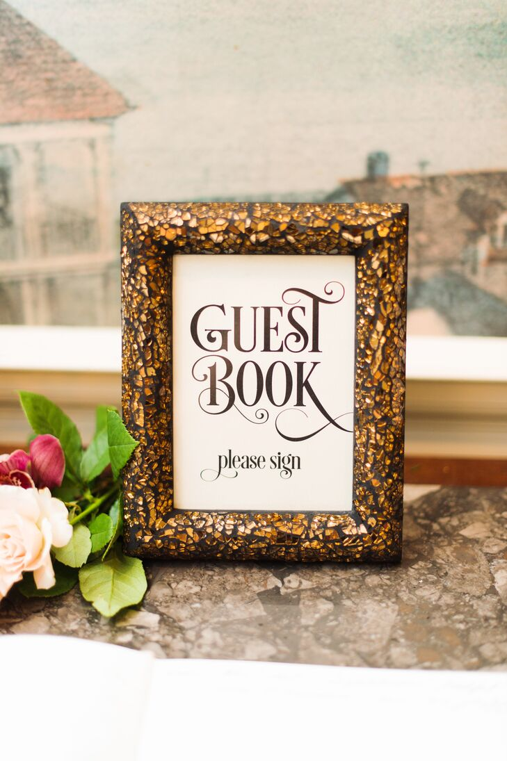 The evening's signs kept with the 1920s glamour theme, featuring vintage-inspired lettering and fanciful gilded frames that twinkled in the candlelight.