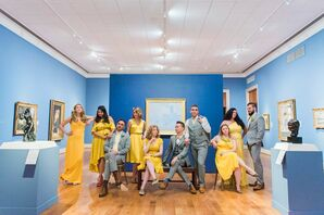 Modern Bridal Party with Yellow Dresses and Light Gray Suits
