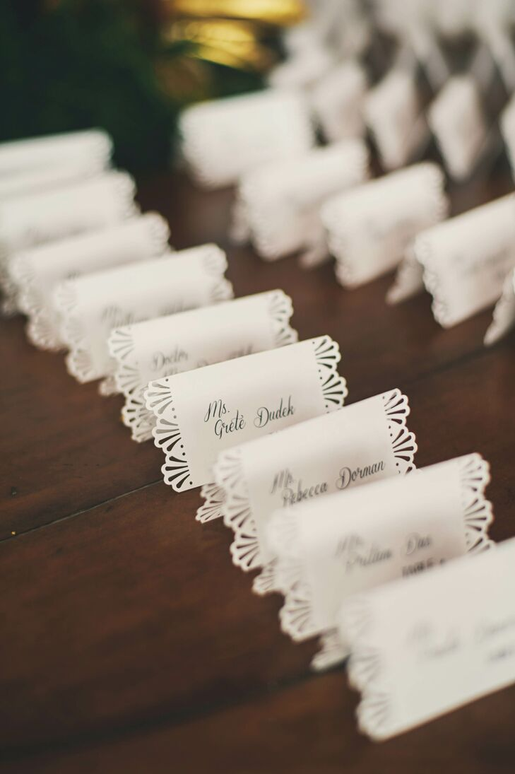Laura, with the help of some of her friends, hand-punched a lace border along the outer edges of each escort card. They were then arranged in a fan shape, on a round table, surrounding a gold candelabra.