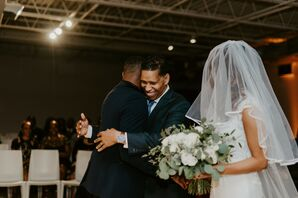 Groom and Father of the Bride Share Hug During Ceremony