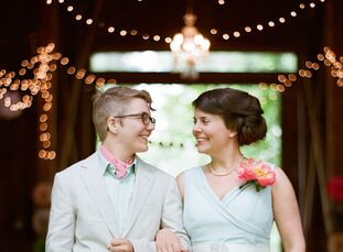 "Amber and Corrie chose bright colors and handmade decorations for their ""springy farm"" wedding."