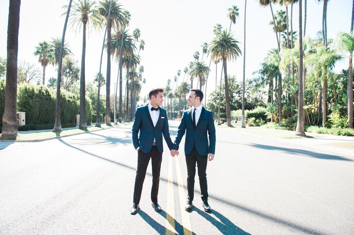 """At their ceremony, Jon and Andrew walked down the white rose-petal-strewn aisle to Edith Piaf's """"La Vie en Rose"""" and Adele's """"Make You Feel My Love,"""" respectively."""