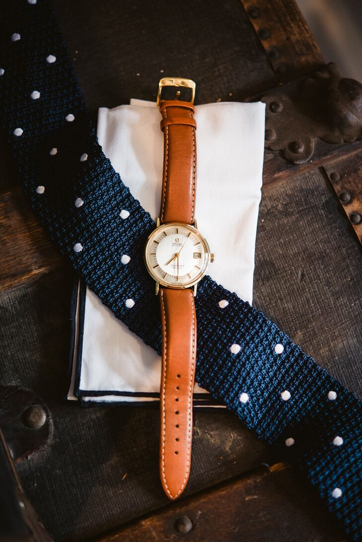 Matt accessorized his custom navy suit with a knitted polka-dot tie from the Tie Bar, his  father's watch, a crisp white pocket square, and a pair of baby blue socks.