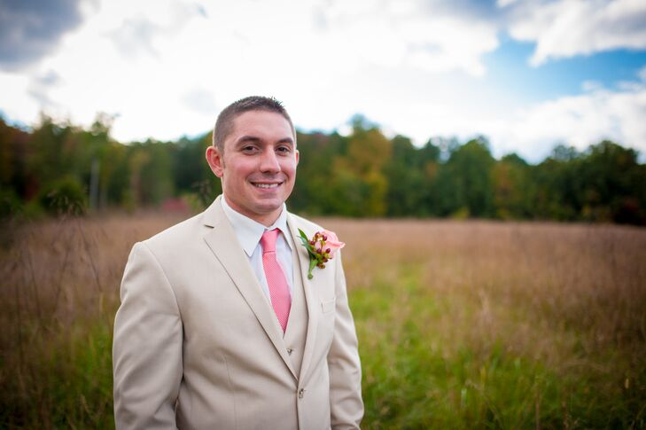 John wore a three-piece, khaki suit with a coral tie and a coral rose boutonniere on his wedding day.