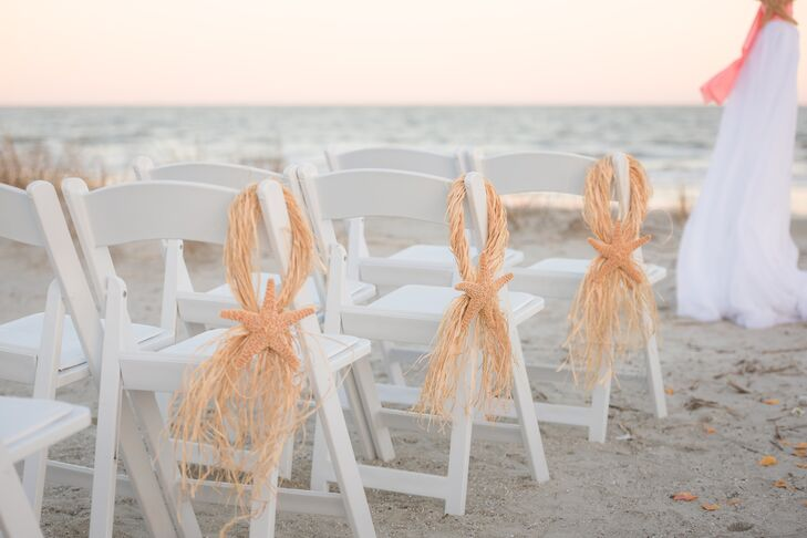 They didn't need much to make their ceremony area look beachy and pretty. The setup was simple with all-white folding chairs arranged to face the ocean and an aisle down the middle. To add to the beach theme, large starfish were tied with twine to chairs on the aisle. The neutral sandy colors fit the theme and didn't distract from the ceremony.