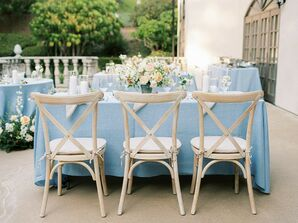 Cross-Back Chairs and Blue Table Linens for Backyard Wedding Reception