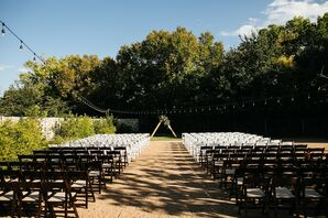 Modern Ceremony Site with Folding Chairs, String Lights and Triangular Wedding Arch