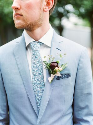 Groom in Pale Blue Suit with Floral Tie