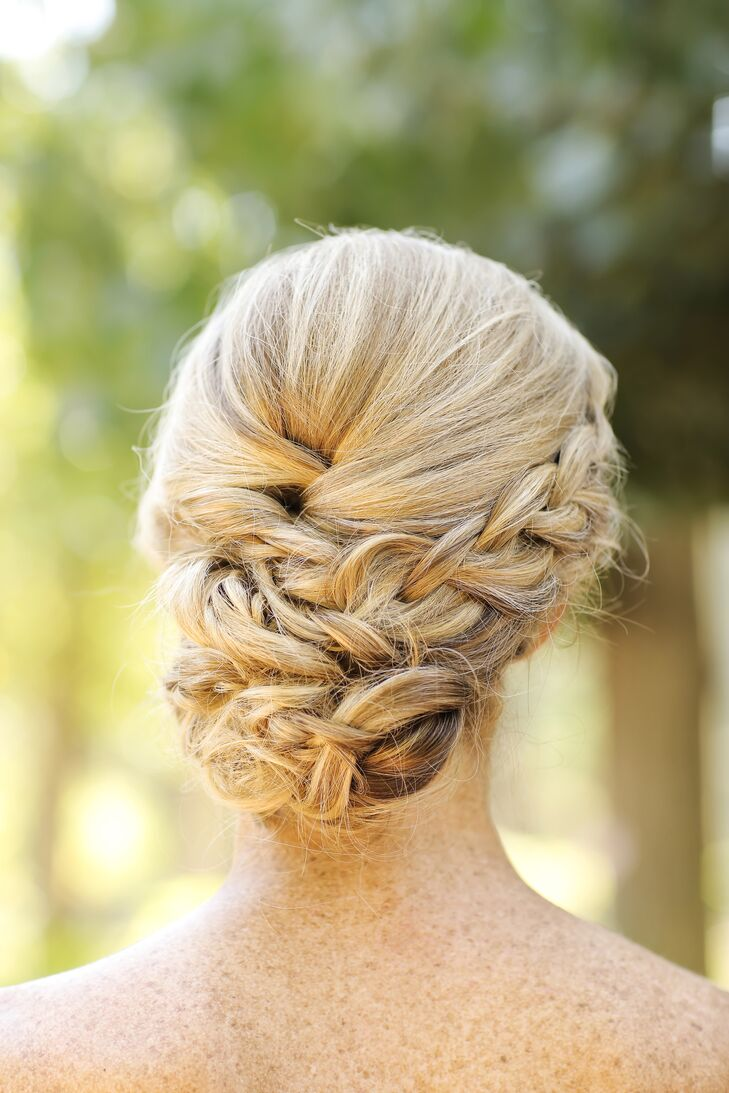 Courtney's side-braided updo by Holladay's Versa Artistry melded old-school romance with contemporary sensibilities.
