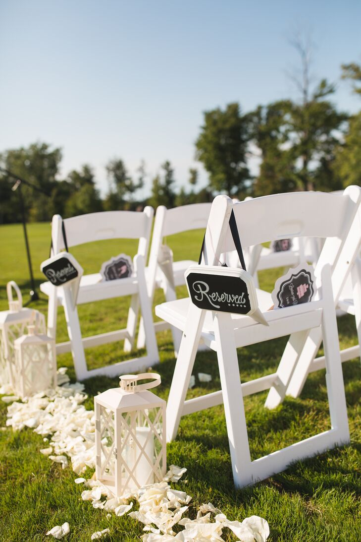 White Chairs And Aisle Decorations