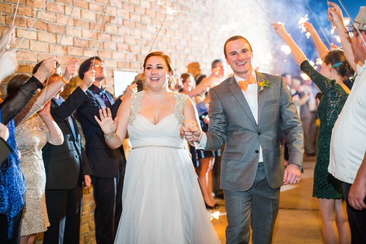 Alison and Piece made their grand exit from the Gallery through a tunnel of sparklers before hopping into a vintage getaway car.