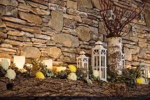 Rustic Lantern and Mixed Yellow Flower Fireplace Decor