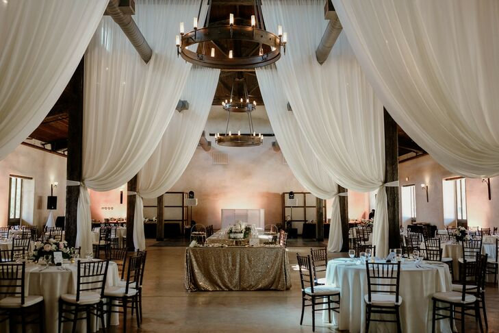 Rustic Reception with White Draping and Wooden Chandeliers