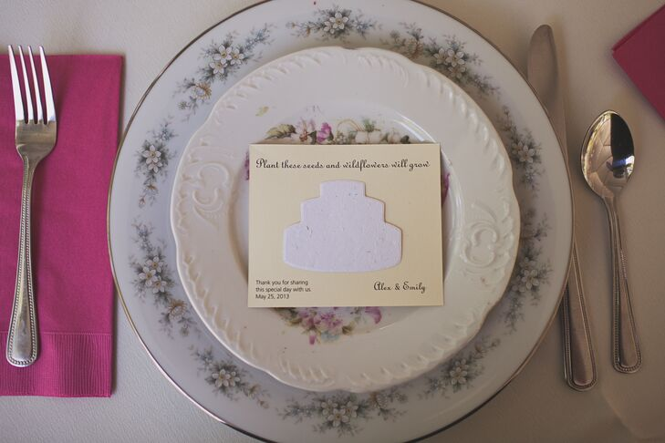 """Emily searched for months for mismatched china. Each of the place settings were topped with wildflower-seed packs that said """"Plant these seeds and wildflowers will grow"""" along with the couple's name and a short thank-you."""