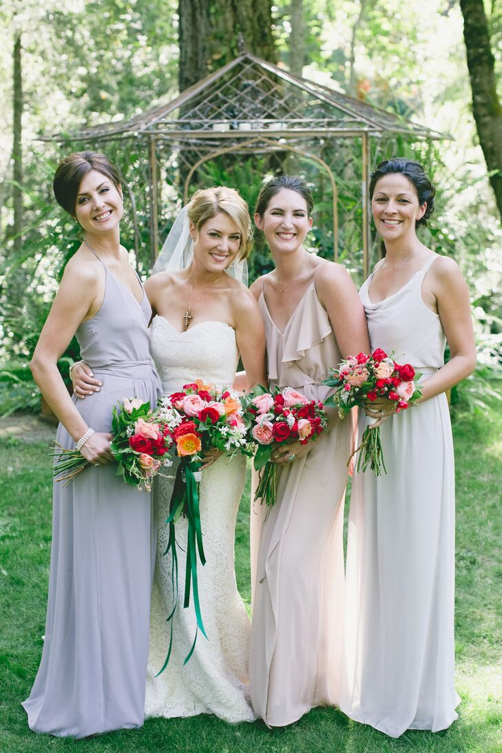 Melanie's bridesmaids wore mismatched neutral gowns and carried vibrant bouquets filled with red and peach blooms.